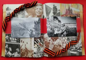 Раскрытая книга с фотографиями Великой Отечественной войны